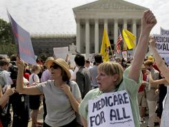 Health care ruling: Joan Stallard of Washington, center, and others demonstrate outside the Supreme Court on Thursday. Many people traveled from other states to Washington for the ruling.