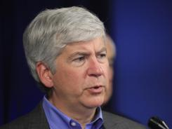 Michigan Gov. Rick Snyder criticized the court's ruling, but said his state would create a health exchange.