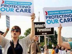 People for and against the Affordable Care Act protest in front of the U.S. Supreme Court.
