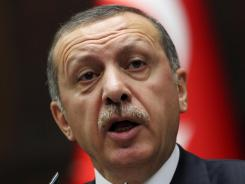 Turkish Prime Minister Recep Tayyip Erdogan addresses lawmakers in Ankara, Turkey, on Tuesday.