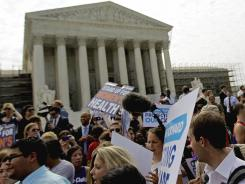 Supporters of President Obama's health care law celebrate outside the Supreme Court in Washington, D.C.