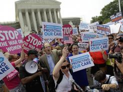 Supporters of President Obama's health care law celebrate on Thursday outside the Supreme Court in Washington.
