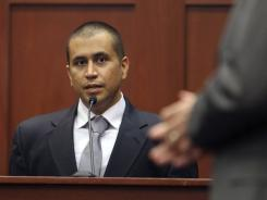 George Zimmerman, left, answers a question from attorney Mark O'Mara during a bond hearing in Sanford, Fla., on April 20.