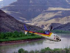 A tour helicopter lifts off inside the Grand Canyon in Arizona.