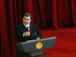Egypt's newly inaugurated president, Mohammed Morsi, speaks at Cairo University in Cairo, Egypt, on Saturday.