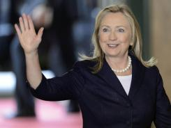 Secretary of State Hillary Rodham Clinton waves as she arrives for a meeting of the Action Group for Syria in Geneva, Switzerland, on Saturday.