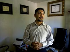Law school graduate Sergio Garcia has passed the California state bar exam but has been prevented from practicing law because his family entered the country illegally.