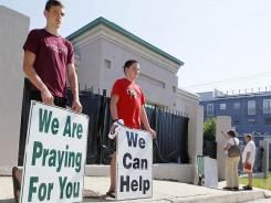 Anti-abortion advocates stand outside Mississippi's only abortion clinic on June 27.