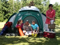 The DuFresnes of Clarkston, Mich., are a family divided when it comes to camping. Peg DuFresne, 55 at right, hates going camping and rarely does it. But, left to right, her daughter Jessica, 29, husband Jim, 56, and son Michael, 26, have enjoyed camping for more than 20 years.