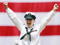 Last July 4: Petty Officer Bridget Lydon after throwing the first pitch at a Red Sox game.