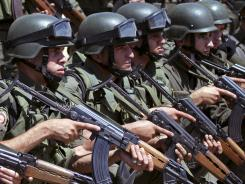 Palestinian security officers take part in a training session in the West Bank town of Jenin on Monday.