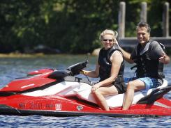 Republican presidential candidate Mitt Romney and his wife, Ann, ride a Jet Ski on New Hampshire's Lake Winnipesaukee on July 2.