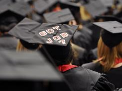 Message from the future: Graduating students at Edinboro University of Pennsylvania in May. America's youth unemployment rate is twice the national average.