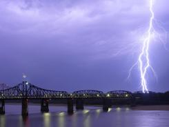 A bolt of lighting lights up the night sky over the Mississippi River bridges in Vicksburg, Miss., on June 11. Lowering water levels at the Mississippi River have raised concerns among state officials.