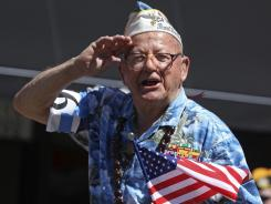 Pearl Harbor survivor: Mickey Ganitch salutes at last July Fourth's parade in Alameda, Calif.