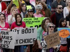 People in Oklahoma rallied in opposition to the state Senate's passage of a bill that granted rights of personhood to fertilized human eggs in February 2012. The measure was later declared unconstitutional by Oklahoma's highest court.
