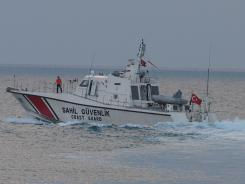 Turkey's coast guard searches on June 24 in the Mediterranean Sea for the Turkish plane that was downed by Syria.