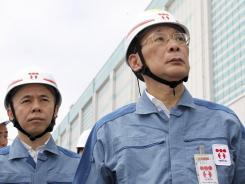 Tokyo Electric Power Chairman Kazuhiko Shimokobe, right, and President Naomi Hirose visit the Fukushima Dai-ni nuclear power plant in northeastern Japan on Wednesday.