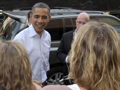 President Obama greets crowds in North Carolina last fall on a bus tour to call attention to his jobs plan. He also visited Virginia on that trip — two Southern states that he carried in 2008.