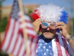 Steve Shannon of Centreville, Va., prepares to ride his motorcycle in the Fairfax, Va., Independence Day Parade on Wednesday.