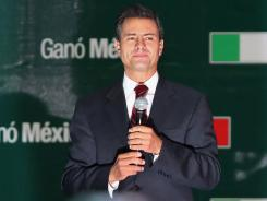 Enrique Pena Nieto gives a victory speech on Sunday in Mexico City.