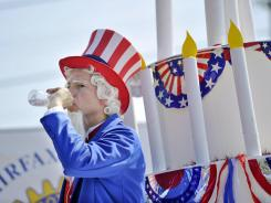 Sean O'Connell, president-elect of the Fairfax, Va., Rotary Club, tries to keep cool during a parade as temperatures rise to near 90 degrees in the late morning Wednesday.