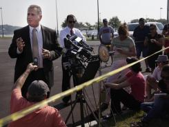 Nassau County Police Department Det. Lt. John Azzata, left, gives information about a fatal boating accident during a news conference in Oyster Bay, N.Y., on Thursday.