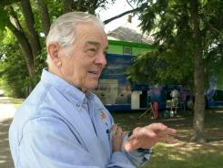 Al Neuharth talks in front of the Freedom Forum's bus, Thursday, June 20, 2002, parked in Eureka, S.D.