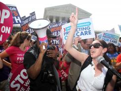 After the 5-4 ruling: Angela Botlicella, right, along with other supporters of the Obama administration's health reform law, celebrate outside the Supreme Court on June 28.