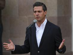 Enrique Pena Nieto speaks to the press after he cast his vote during general elections in Atlacomulco, Mexico, on Sunday.