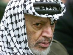 Yasser Arafat during weekly Muslim prayers in the West Bank city of Ramallah.