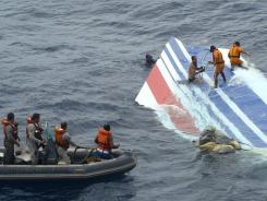 Brazil's Navy sailors recovering debris from the missing Air France jet at the Atlantic Ocean in 2009.