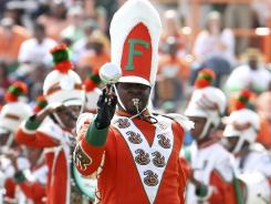 In this Oct. 8, 2011 file photo, Florida A&M Drum Major Robert Champion performs during halftime of a game against Howard University at Bragg Memorial Stadium in Tallahassee, Fla.