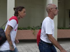 "Americans Jason ""Zeke"" Petrie, left, and Steven Parker Shaw, right, leave a courthouse in Port-au-Prince, Haiti on Friday."