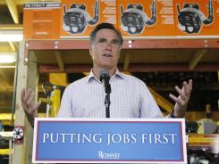 "Mitt Romney holds a brief news conference in Wolfeboro, N.H., on Friday. He called the latest jobs report ""a kick in the gut."""