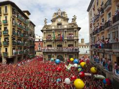 Revelers hold up traditional red neckties during the 'Chupinazo,' the official opening of the 2012 San Fermin fiestas on Friday in Pamplona, Spain.