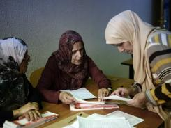 Libyan polling station workers check electoral material on the eve of the country's general election.