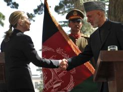 Afghan President Hamid Karzai shakes hands with U.S. Secretary of State Hillary Clinton at the conclusion of a press conference at the Presidential Palace in Kabul on Saturday.