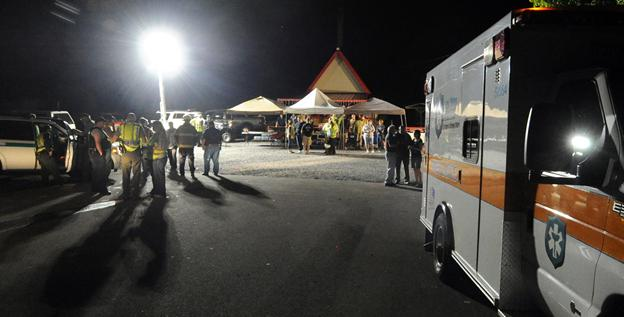 Rescue workers gather at a makeshift command center near Great Smoky Mountains National Park.