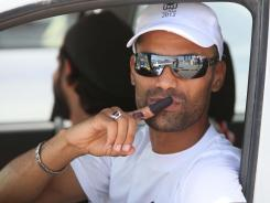 A Libyan man kisses his ink-marked finger that shows that he has voted as he drives in Tripoli, Libya, on Saturday.