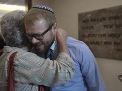 Reform Judaism convert Robert Burchfield, gets a hug after a Shabbat service in at The Temple, Congregation Ohabai Sholom in Nashville, Tenn.
