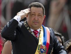 Venezuelan President Hugo Chavez salutes before a military parade Thursday during the anniversary of the declaration of independence in Caracas.