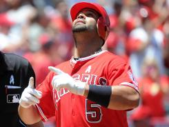 Higher power: Albert Pujols of the Los Angeles Angels celebrates after hitting a home run last month. He's not the only athlete who thanks God for on-field accomplishments.