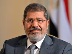 Egyptian President Mohammed Morsi called for the return of the country's parliament, which had been dissolved by the military.