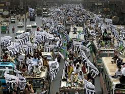 Supporters of the Defense Council of Pakistan take part in Sunday's rally in Lahore, Pakistan.