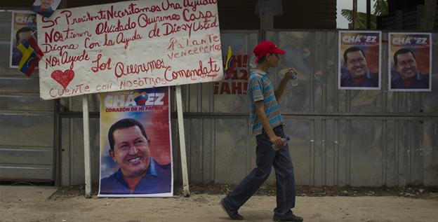 Posters hang along a street in Mariara, Venezuela, as Chavez announced his re-election bid on July 1.