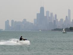 A man rides a Jet Ski in Lake Michigan at Montrose Beach in Chicago. Illinois is one of 44 states requiring some form of education before operating personal watercraft.