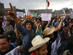 Demonstrators shout slogans as they gather at Zocalo Plaza in Mexico City on Saturday to protest the outcome of the country's presidential election.