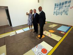 Mayor Michael Bloomberg, center, stands in a full-scale mockup of a 300-square-foot apartment on Monday.