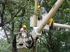 Utility crews install a new transformer in Elkton, Va., on Thursday.